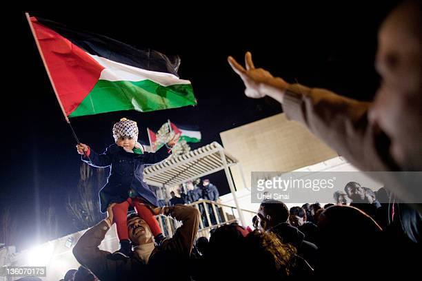 Palestinians celebrate as they wait for the release of Palestinian prisoners on December 18 2011 in Ramallah West Bank Israel released 550...