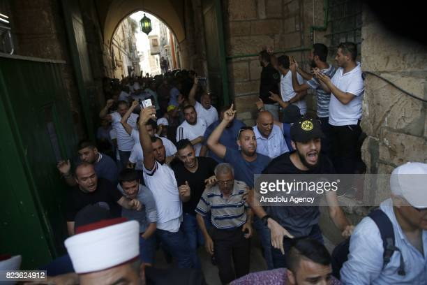 Palestinians celebrate following the removal of Israeli security measures at the entrances to Al Aqsa Mosque Compund in Jerusalem on July 27 2017...