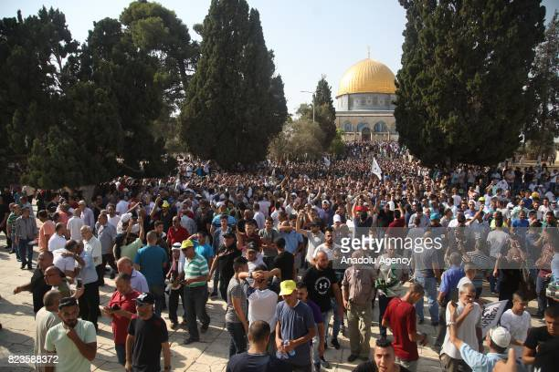 Palestinians celebrate following the removal of Israeli security measures near the entrances to Al Aqsa Mosque Compund in Jerusalem on July 27 2017...