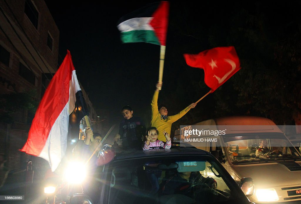 Palestinians celebrate in the street of Gaza City on November 21, 2012 as a ceasefire came into effect in and around Gaza after a week of cross-border violence between Israel and Palestinian militants that killed at least 160 people.