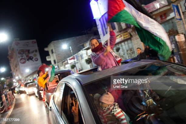 Palestinians celebrate in the streets on November 29 2012 in Ramallah the West Bank The UN General Assembly today voted 1389 with 41 abstentions to...