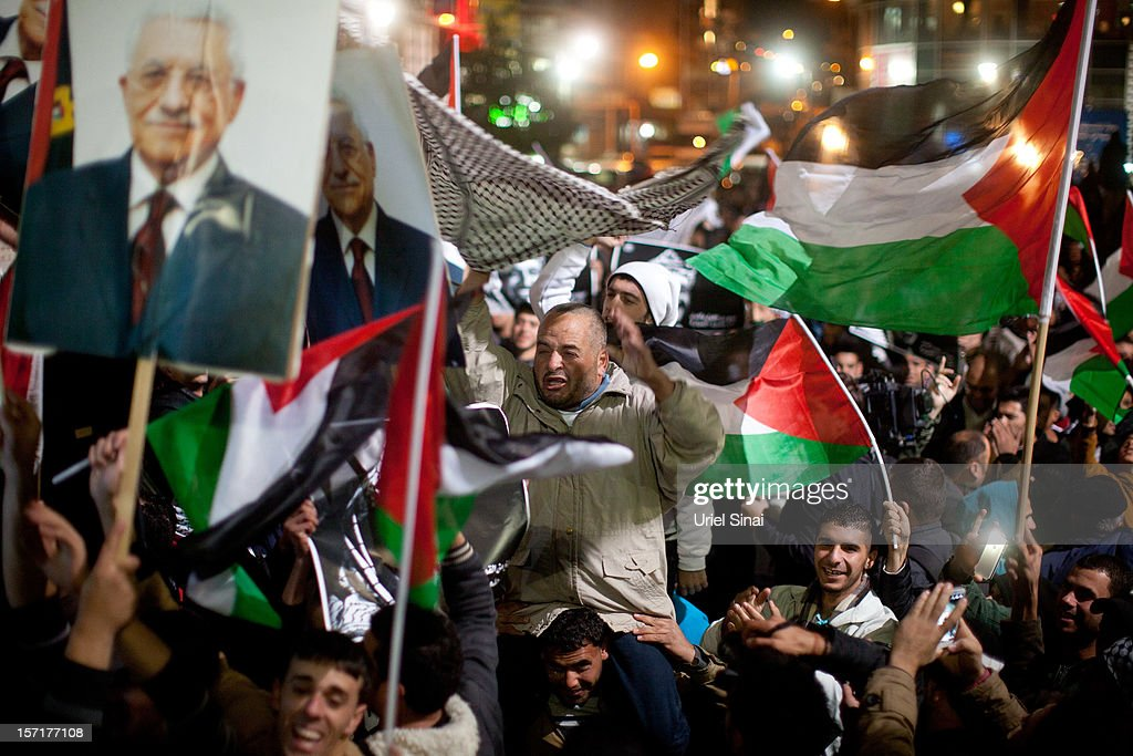 Palestinians celebrate in the streets on November 29, 2012 in Ramallah, the West Bank. The U.N. General Assembly today voted 138-9, with 41 abstentions, to upgrade the Palestinian Authority's status to non-member observer state. Among nations voting no were the U.S., Israel and Canada.