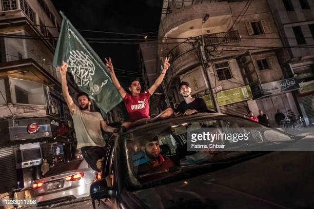 Palestinians celebrate the cease-fire agreement between Israel and Hamas on May 21, 2021 in Gaza City, Gaza. Yesterday, Israel's cabinet and Hamas,...