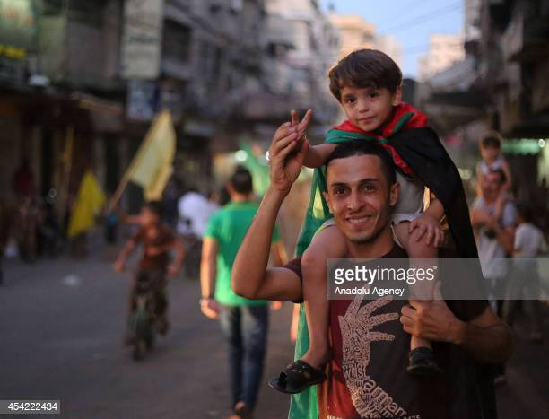 Palestinians celebrate the ceasefire between Palestinian resistance factions and Israel in Khan Younis southern Gaza Strip on August 26 2014 An...