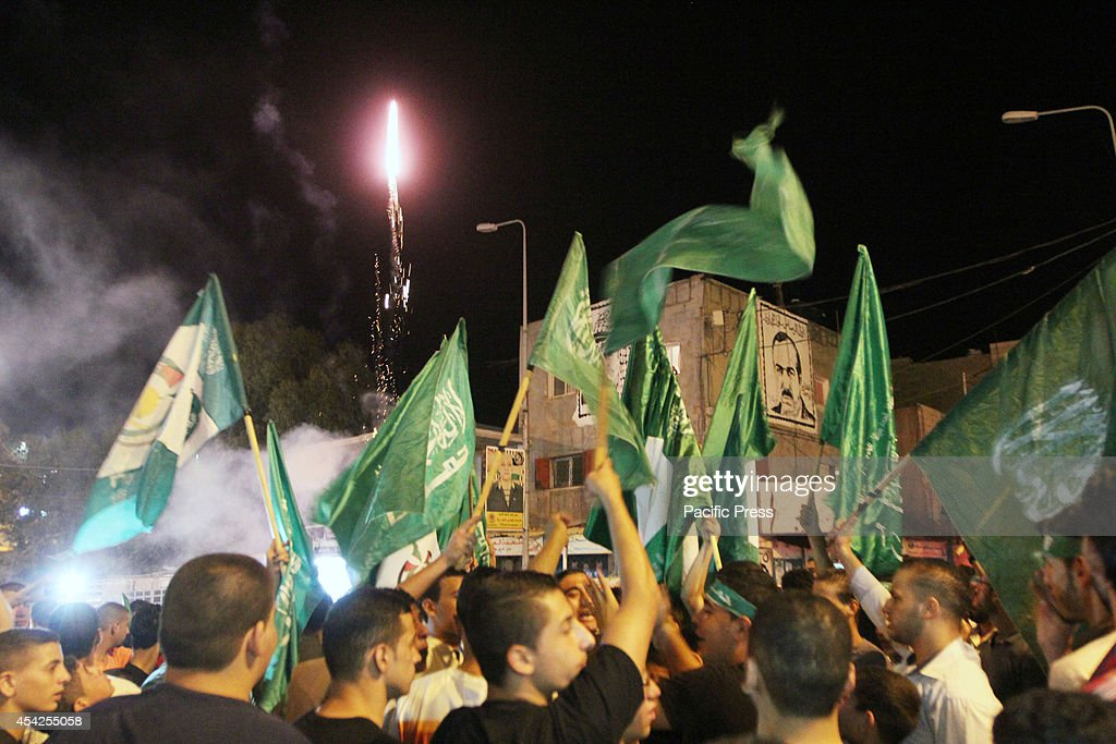 Palestinians celebrate the newly agreed cease-fire  between...