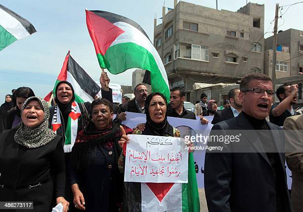 Palestinians celebrate the reconciliation agreement following the meeting about to end Palestinian divisions between Fatah and Hamas movement in Gaza...