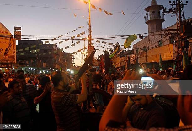 Palestinians celebrate what they said was a victory over Israel, following a ceasefire in Gaza strip.