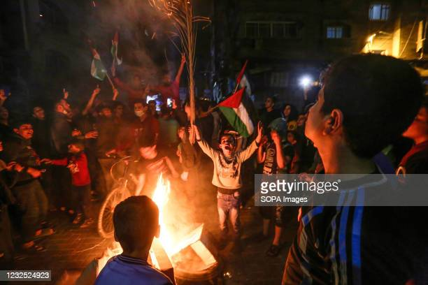 Palestinians chant slogans as they burn tires during a rally in support of the Al-Aqsa Mosque in Gaza City. Palestinians raged last night in occupied...