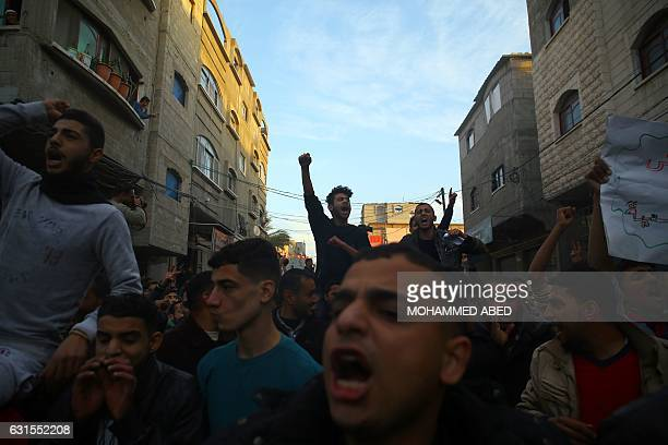 Palestinians chant slogans during a protest against the ongoing electricity crisis in Jabalia refugee camp in the northern Gaza Strip on January 12...