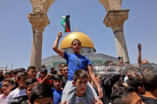 Palestinians chant slogans during Friday prayers in Jerusalem's Al-Aqsa mosque compound, the third holiest site of Islam, which is also revered by...