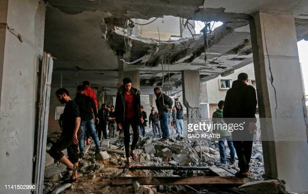 Palestinians check the damage in a building targeted by Israeli airstrikes on Rafah in the southern Gaza Strip on May 5, 2019. - Israel's military...