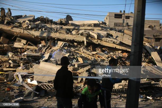 Palestinians check the damage in a residential neighbourhood in Gaza City early on November 13 following Israeli air strikes targeting the area...