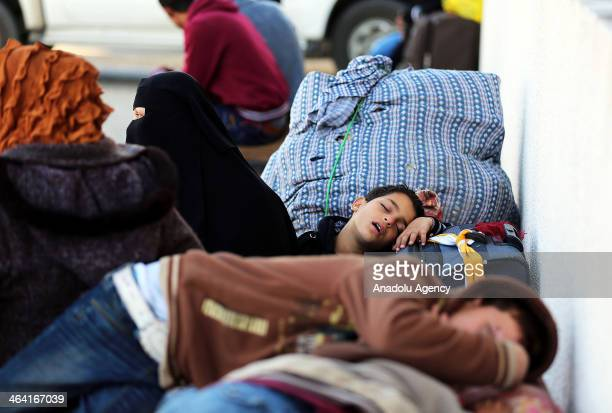 Palestinians children sleep at the Rafah crossing between Egypt and the southern Gaza Strip on January 21 2014 Egyptian authorities partially opened...