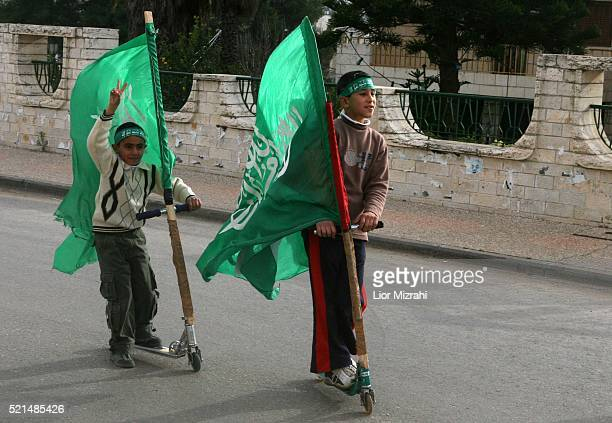 Palestinians children with Hamas flags on the street in the West Bank city of Ramallah, Tuesday, January 24, 2006. Palestinian parliamentary...