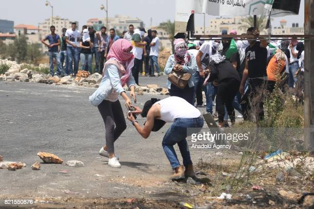 Palestinians clash with Israeli forces during a protest against the Israeli restrictions on the AlAqsa at the Beit El control point in Ramallah West...