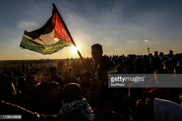Palestinians clash with Israeli forces during confrontations near the fence along the border with Israel in east of Rafah in the southern Gaza Strip...