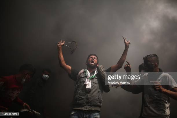 Palestinians clash with Israeli forces in response to Israeli soldiers' intervention as part of the Great March of Return demonstration in Khan Yunis...