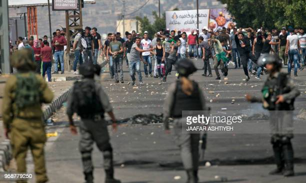 Palestinians clash with Israeli security forces after a protest marking Nakba or catastrophe commemorating the more than 700000 Palestinians who fled...