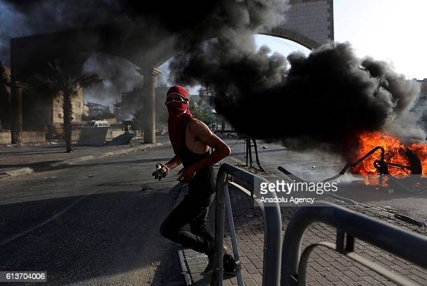 Palestinians clash with Israeli security forces during a protest showing solidarity with Misbah Abu Sbeih in the West Bank town of alRam north of...