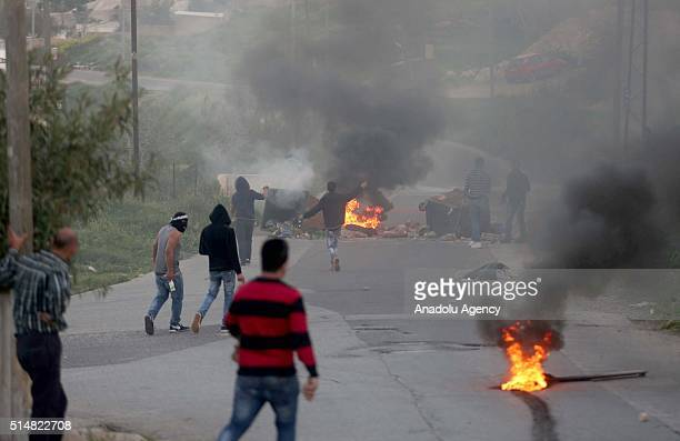 Palestinians clash with Israeli security forces during a protest against the separation wall and Jewish settlement near the Ofer prison in the west...