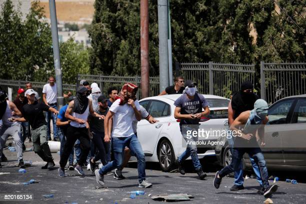 Palestinians clash with Israeli security forces during a demonstration to protest metal detectors installed by Israeli authorities to AlAqsa Mosque...