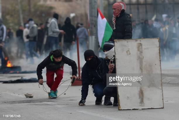 Palestinians clash with Israeli security forces following their intervention in a protest against U.S. President Donald Trump's Middle East plan, in...
