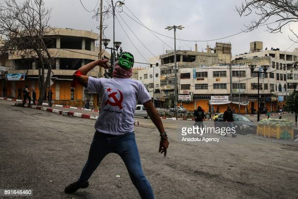 Palestinians clash with Israeli soldiers during a protest against US President Donald Trumps announcement to recognize Jerusalem as the capital of...
