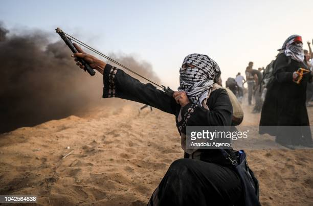 "Palestinians clash with Israeli troops during the ""Great March of Return"" demonstration near Israel-Gaza border, in Khan Yunis, Gaza on September 28,..."