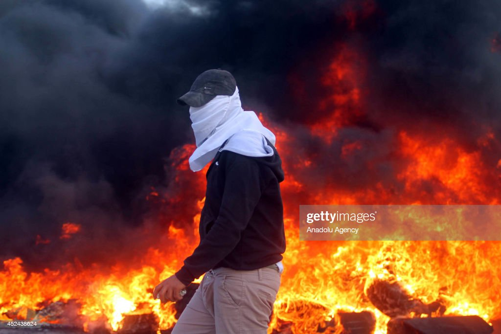 Palestinians clashes with Israeli troops following the protest against the Israeli operations in Gaza at the al-Jalazone Camp in Ramallah, West Bank on July 20, 2014.
