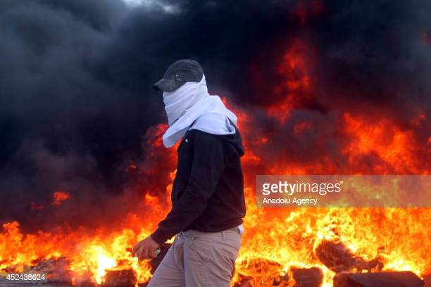 Palestinians clashes with Israeli troops following the protest against the Israeli operations in Gaza at the al-Jalazone Camp in Ramallah, West Bank...