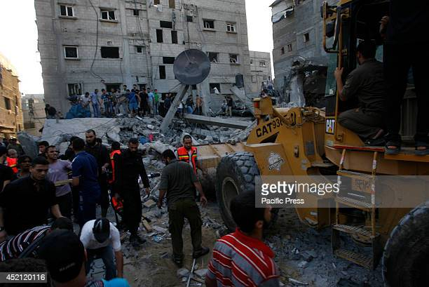 Palestinians clear the rubble of the house after it was targetted in an air raid on Rafah, in the south of the Gaza strip. Five Palestinians,...