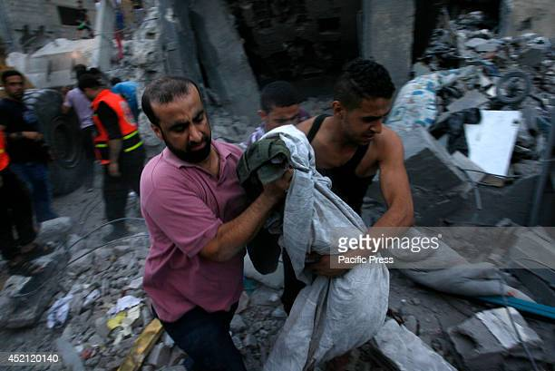 Palestinians clear the rubble of the house after it was targetted in an air raid on Rafah, in the southern of Gaza strip. Five Palestinians,...