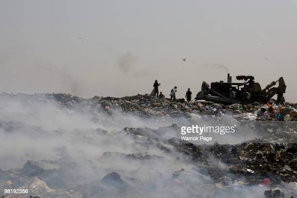 Palestinians collect plastic to be sold for recycling from a landfill March 23, 2010 at the Gaza and Israel border. Hamas' Ministry of Economics...