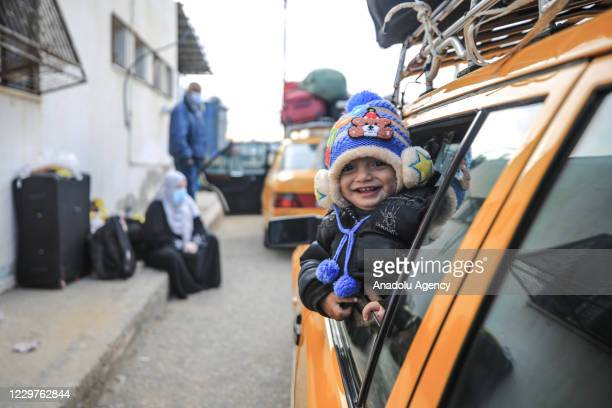 Palestinians cross the border after Egypt exceptionally opened the Rafah border crossing with the Gaza Strip for three consecutive days in both...