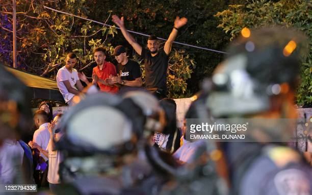 Palestinians demonstrate against a possible eviction of Palestinian families as part of an ongoing effort by Jewish Israelis to take control of homes...