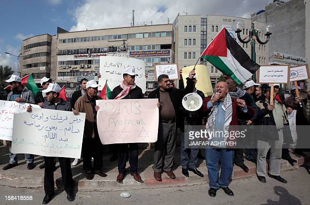 Palestinians demonstrate against the Paris Protocol and the Oslo Agreement both key accords which govern economic ties between Palestinians and...