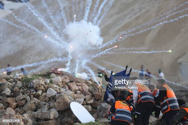 Palestinians demonstrator use throw firework during a protest against US President Donald Trumps announcement to recognize Jerusalem as the capital...