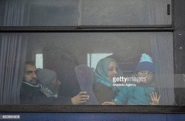Palestinians depart from the Rafah Border crossing after the gate temporarily reopened in Rafah Gaza on January 28 2017 Egyptian authorities opened...