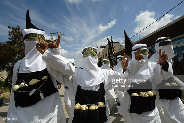 Palestinians dressed up as suicide bombers take part in a rally organized by both the alAqsa Martyrs Brigades loosely affiliated to President Mahmud...