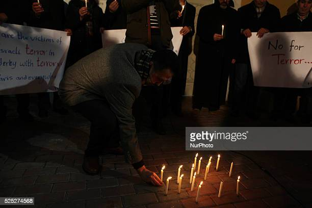 Palestinians during the lighting of candles in front of the French Consulate office in Gaza to show solidarity in the wake of the shooting by gunmen...
