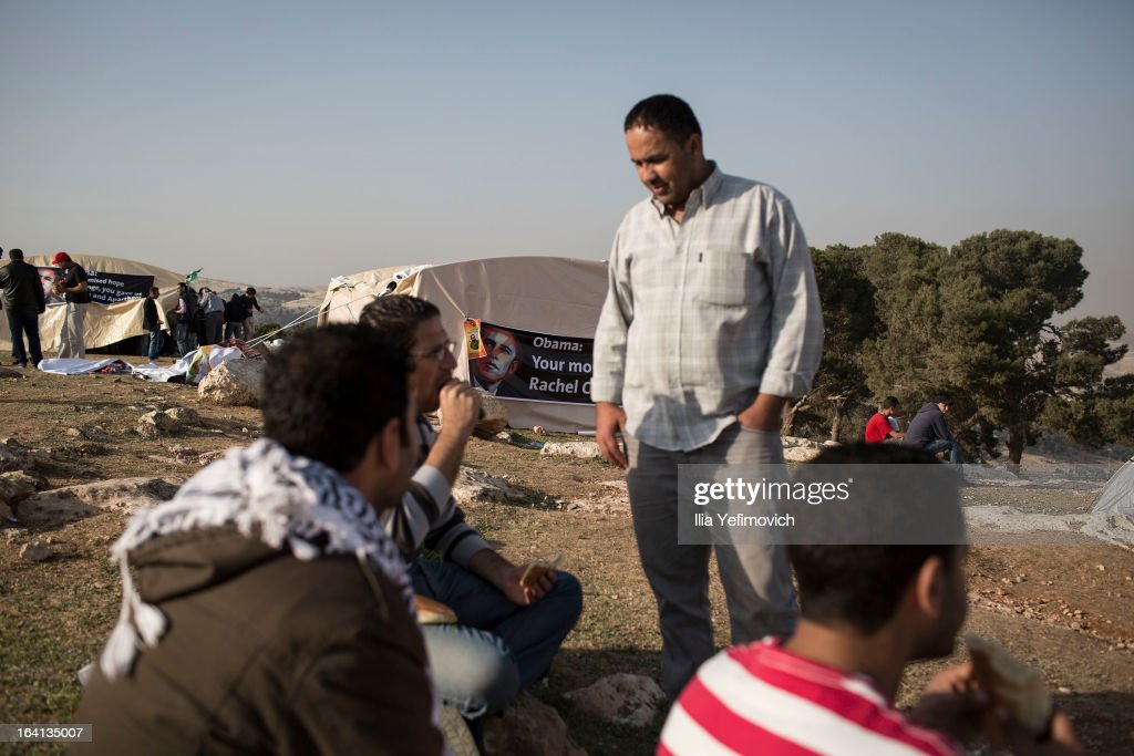 MA'ALE, ADUMIM, WEST-BANK - MARCH 20: Palestinians eat as Palestinians erect protest tents in a camp on March 20, 2013 in the E1 area next to Ma'ale Adumim. The action took place at the same time as U.S. President Barack Obama arrived to Ben Gurion airport near Tel Aviv. This will be Obama's first visit as President to the region, and his itinerary will include meetings with the Palestinian and Israeli leaders as well as a visit to the Church of the Nativity in Bethlehem.