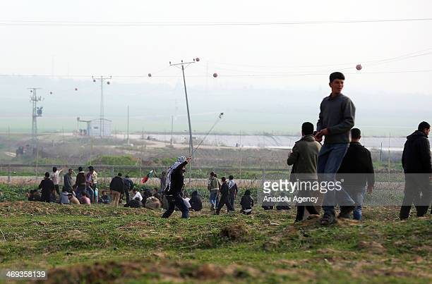 Palestinians escape from tear gas during clashes with Israeli forces near the IsraelGaza border east of Jabalia refugee camp in northern Gaza Strip...