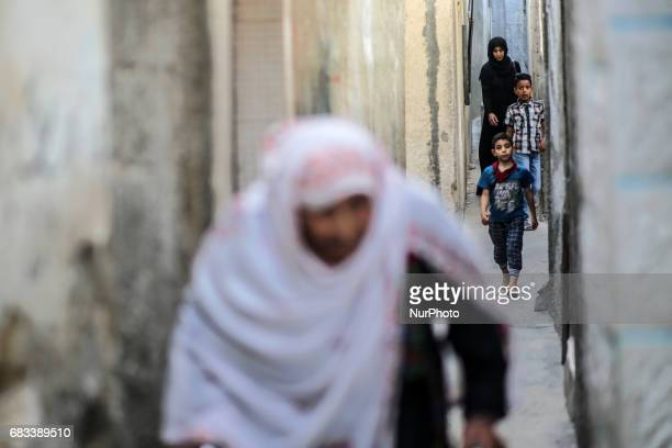 Palestinians family walk at street in Jabalia camp refugees Northern Gaza strip on 15 May 2017 Hosam Salem quotNakbaquot means in Arabic...