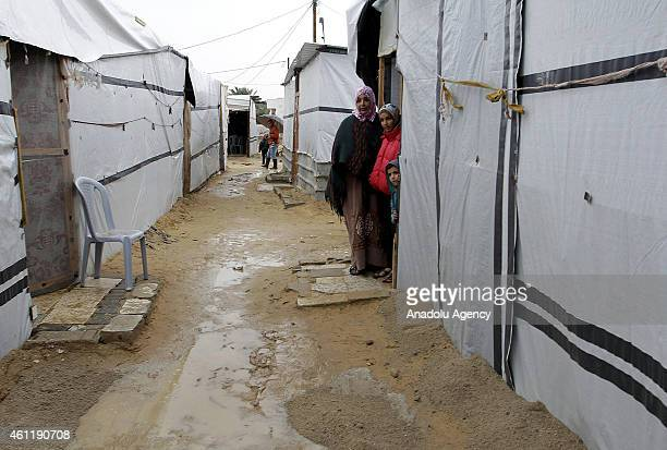 Palestinians fled their home due to the Israeli attacks living in the refugee camp hold on life in cold weather conditions in Khan Yunis city of Gaza...