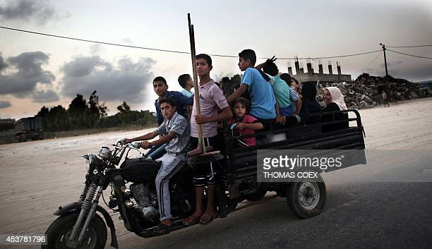 Palestinians flee their destroyed neighbourhood to head to a United Nations school to take refuge for the night in the northern Gaza Strip city of...