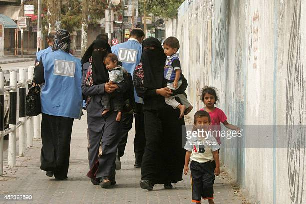 Palestinians flee their houses following an Israeli ground offensive in Rafah in the southern Gaza Strip. Israel launched a Gaza ground campaign...