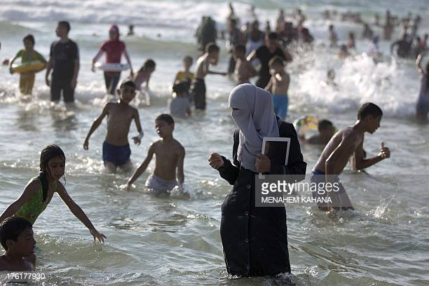Palestinians from the West Bank enjoy the Tel Aviv beach a day after the EidalFitr festival marking the end of the holy fasting month of Ramadan on...