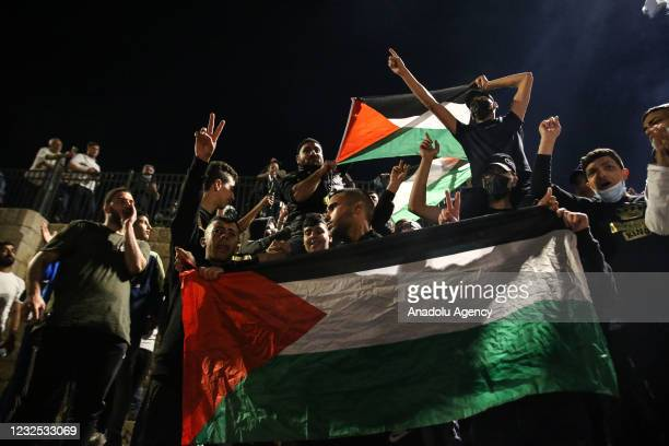Palestinians gather after Israeli forces withdrew from the Damascus Gate area in central Jerusalem after having closed it to Palestinians since the...