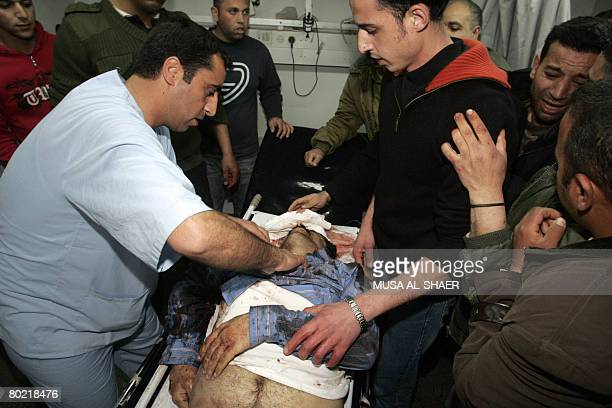 Palestinians gather around the body of the body of Islamic Jihad militant Eissa Marzuk after he was killed by Israeli undercover forces in the West...