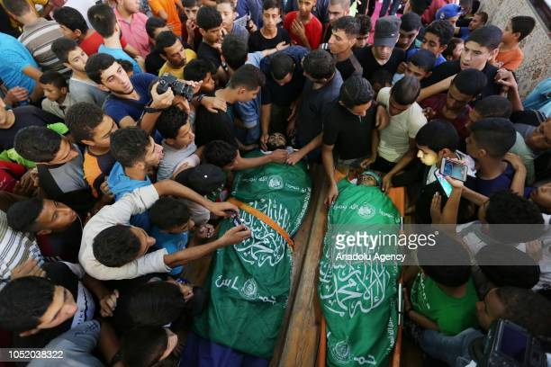 Palestinians gather around the dead bodies of Ahmed Ibrahim Zaki alTaweel and Ahmad Ahmad Abu Naim who were killed after Israeli soldiers intervened...